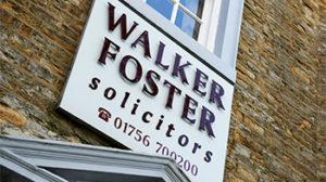 Main walker foster sign above main entrance