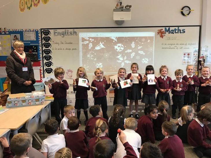 kids presenting their paintings