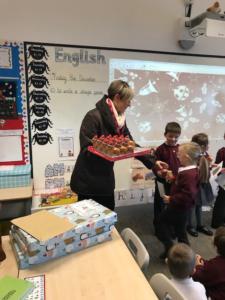girl receiving chocolate reindeer