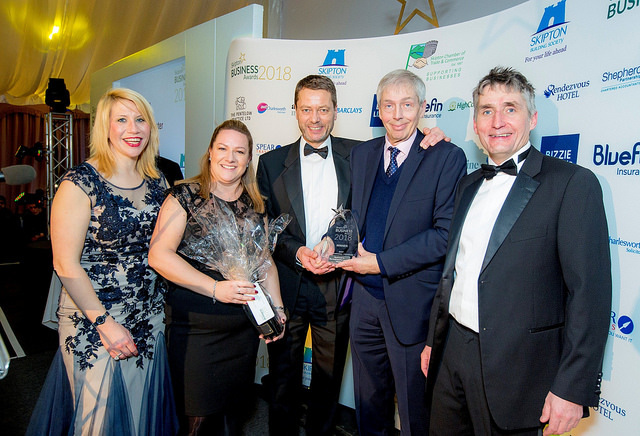 walker foster team accepting award