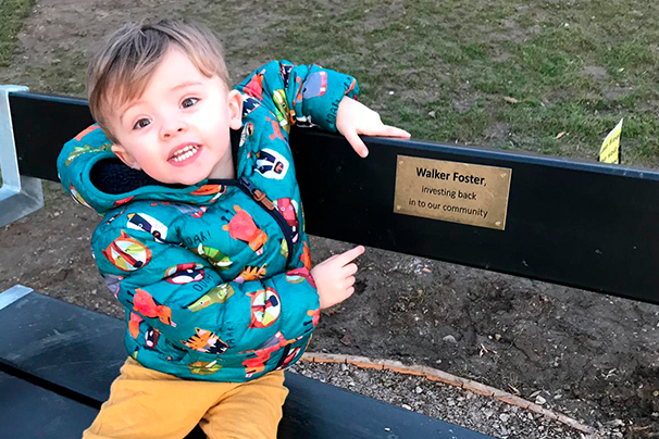 George pointing at bench plaque
